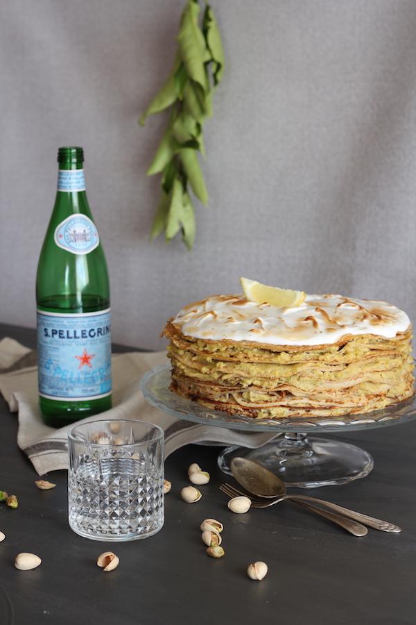 Mille Crêpes cake with cream of pistachios and flambé meringue